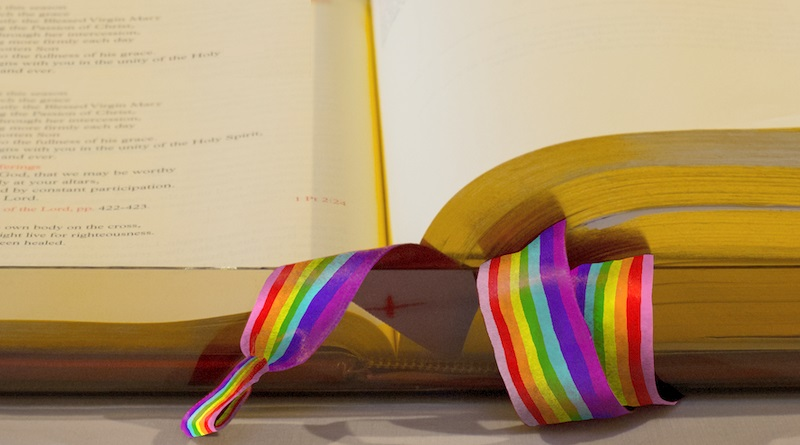 Bible and rainbow marks